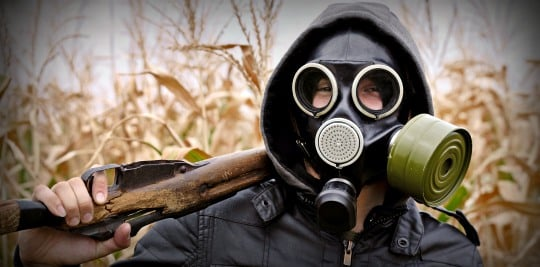 Gas Mask On A Man With A Rifle
